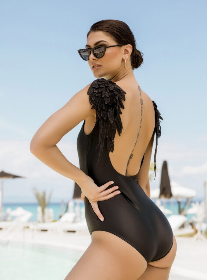 One piece with feather details and an open back